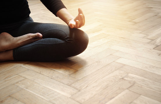 adult woman in yoga meditation relaxation post sport on the old wood floor