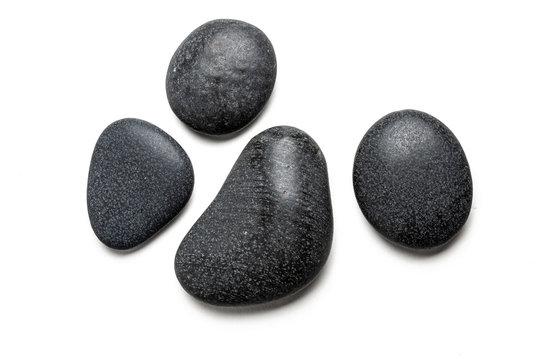Four big black pebbles