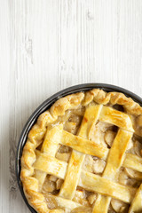 Homemade apple pie on white wooden background, view from above. Flat lay, overhead, top view. Copy space.