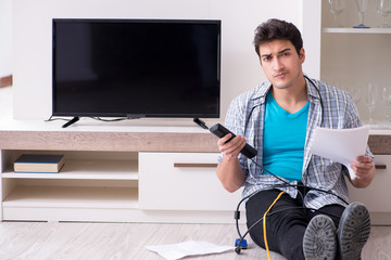 Man trying to fix broken tv