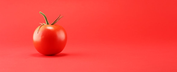 tomato on red background. italian healthy vegan food concept with tomatoes. Fototapete