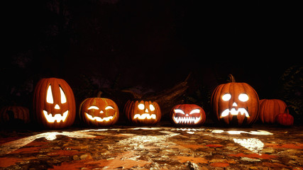 A few various funny carved halloween pumpkins on a ground covered by fallen autumn leaves in dark scary forest at night. Fall season festive 3D illustration.