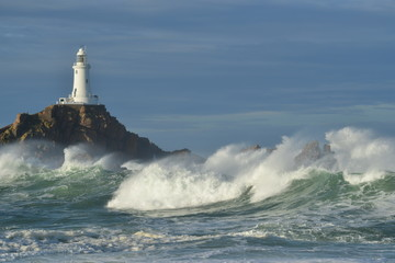 La Corbiere lighthouse, Jersey, U.K. Storm Callum whips up the Atlantic Ocean.