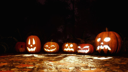 Close up of various Jack-o-lantern carved halloween pumpkins on a ground covered by fallen autumn leaves in scary forest at dark night. Festive 3D illustration.