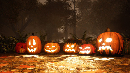 Close up of various Jack-o-lantern carved halloween pumpkins on a ground covered by fallen autumn leaves in misty forest at dusk or night. Festive 3D illustration.