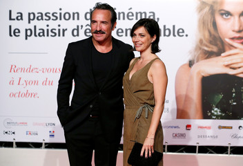 Dujardin and his partner attend the opening of the Lumiere 2018 Grand Lyon Film Festival in Lyon