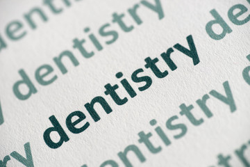 word dentistry  printed on  paper macro