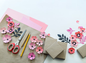 Packing a festive box with ribbons and flowers