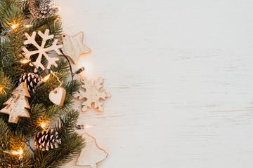 Wall Mural - Christmas background - fir leaves and  rustic elements decorating on white wood table. Creative Flat layout and top view composition with border and copy space design.