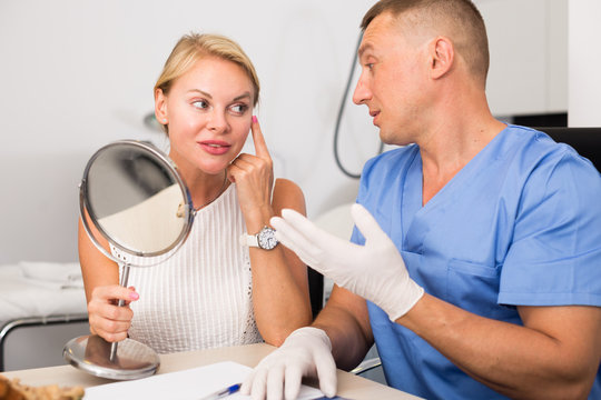 Woman is talking with specialist about halthy of skin of face