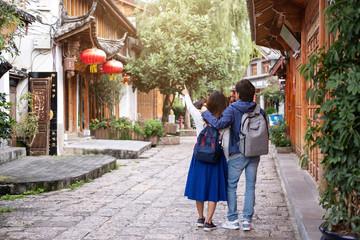 Young couple traveler walking at lijiang old town