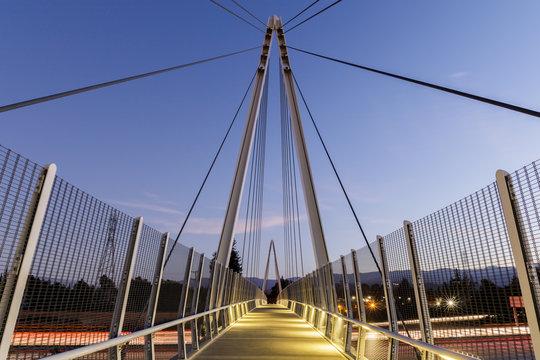 Dusk over Don Burnett Bicycle-Pedestrian Bridge (aka Mary Avenue Bicycle Footbridge). Cupertino, Santa Clara County, California, USA.