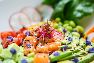 Delicious fresh green salad with salmon,avocado and black rice.
