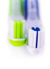Two toothbrushes over white background