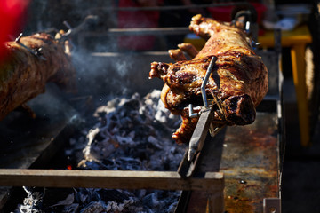 The image of a pig on a spit.