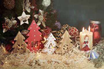 Four decorative wooden Christmas trees with carved letters xmas and delicacy in the form of a small bones for pets. Horizontal.