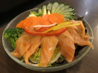Salmon Salad with Seafood Sauce Decorated with fresh vegetables.