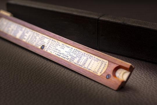 Close up shot of a antique 1915 slide rule, vintage retro concept.