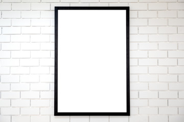 A blank black wooden picture frame on white brick wall background