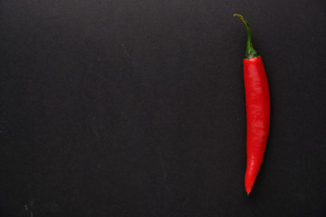 Canvas Prints Hot chili peppers Red hot chili pepper on black background top view with copy space