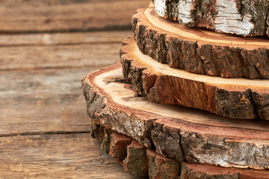 Natural round wood slices with bark. Stack of wooden discs for decor. Wooden round pieces for wedding decor.