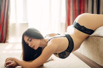 Seductive naked girl in sexy black underwear