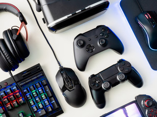 gamer workspace concept, top view a gaming gear, mouse, keyboard, joystick, headset and mouse pad on white table background
