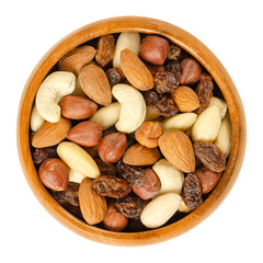 Nuts and raisins in wooden bowl. Snack mix of dried almonds, hazelnuts, cashews and raisins.