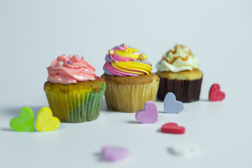 Colorful cupcakes on a white background