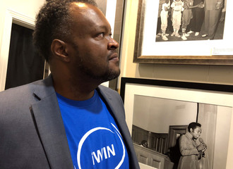 Mason, a Memphis Democrat, studies photographs from the Civil Rights era in Memphis