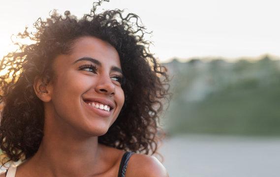 Outdoor portrait of smiling african american girl