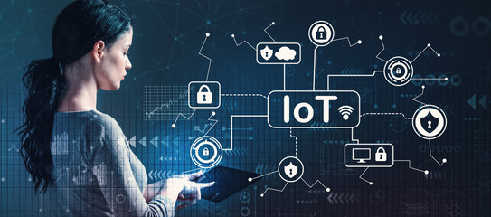 IoT security theme with business woman using a tablet computer