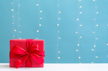 Christmas gift box on a shiny light blue background