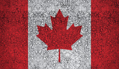Canadian flag drawn with paint on road asphalt