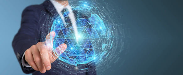 Businessman using digital triangle exploding sphere hologram 3D rendering