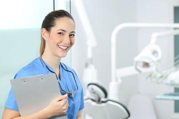 Happy dentst posing in a dental clinic