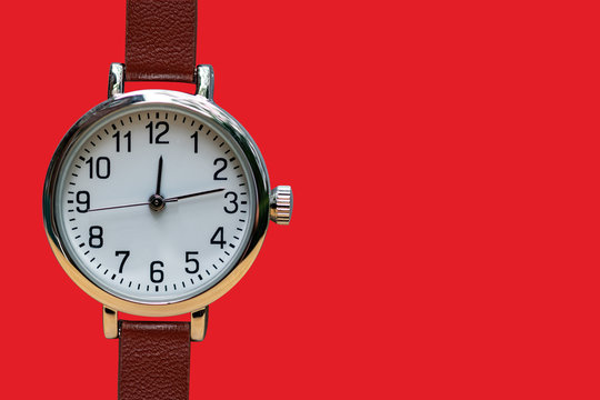 Analog wrist watch isolated on red with copy space