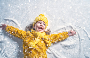 Kid making snow angel.