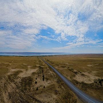Sandy desert and marshy shores of Zaisan Lake, East Kazakhstan.