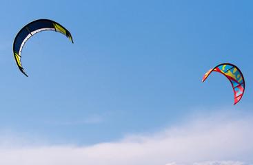 Kites flying in the sky. Kiteboarding kites.