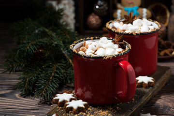 cozy winter drink hot chocolate in red mugs, closeup