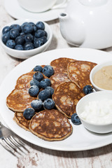 pancakes with peanut butter and yoghurt on white background, vertical