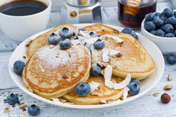 pancakes with fresh blueberries and honey for breakfast, closeup