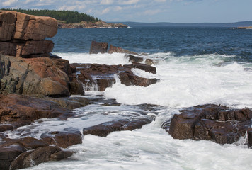 Waves hitting Granite rock in the shore of Acadia National Park, USA