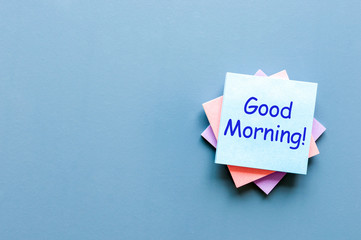 Good morning - wish for a good day. Note at blue background. With empty space for text, mockup and template