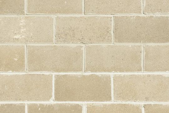 Block brick wall background texture. Brick fence.