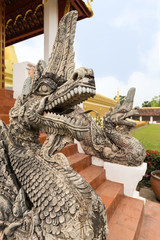 Close-up of an ornate dragon statue at the Pha That Luang, Great Stupa, in Vientiane, Laos.