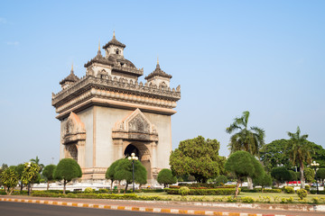 Patuxai (Patuxay), Victory Gate or Gate of Triumph, war monument and park in Vientiane, Laos, on a sunny day.