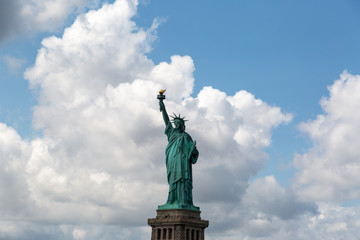 New York City / USA - AUG 22 2018: The statue of liberty in clear blue sky view from river