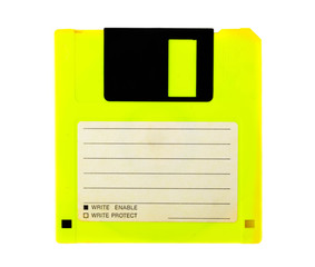Yellow floppy disk with blank label on white background. Magnetic means of storing information.